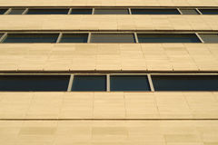 Office building perspective concrete and windows wall Royalty Free Stock Photo