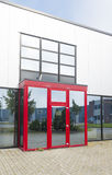 Office building with red entrance. Exterior of a modern office building with red entrance Royalty Free Stock Image