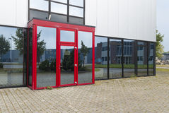 Office building with red entrance. Exterior of a modern office building with red entrance Stock Photo