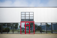 Office building with red entrance. Exterior of a modern office building with red entrance Stock Photos