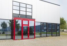 Office building with red entrance Royalty Free Stock Image