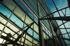 Office Building refelctions. Reflection of structure on glass walls of office building royalty free stock photos