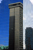 Office Building Reflected. An office building is reflected in another building Stock Image