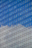 Office building with reflection of clouds Royalty Free Stock Photography