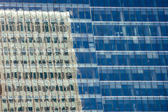 Office Building Reflection in Windows Stock Photography