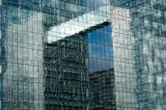 Office building reflection. Reflection in the windows of an office building Stock Image