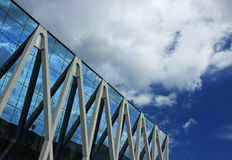 Office building reflections. Clouds being reflected in a modern corporate office building Royalty Free Stock Images