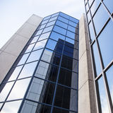 Office building and reflections of clouds Stock Photos
