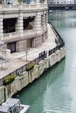 Office building by river. Exterior of old office building by river in downtown Chicago, U.S.A Stock Image