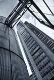 Office building and silo Stock Images
