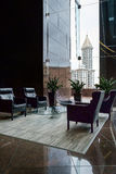 Office building sitting area. Sitting area on 40th floor of Columbia Center building in Seattle with Smith Tower visible through a window in the background stock photo