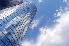 Office Building and sky #2. A mirrored building reflecting the blue sky and clouds Royalty Free Stock Photography