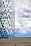 Office building and sky. Architectural detail - office wal and staircase against a cloudy sky Stock Images