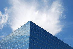Office Building and sky #3. A mirrored building reflecting the blue sky and clouds Stock Photography
