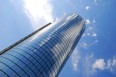 Office Building and sky #5. A mirrored building reflecting the blue sky and clouds Royalty Free Stock Photo