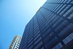 Office building on sky background Стоковое Изображение RF