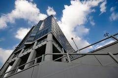 Office building on sky background Lizenzfreie Stockbilder