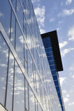 Office building – sky and clouds. Modern architecture – façade of an office building with reflection of clouds and sky royalty free stock photography