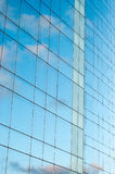 Office building and sky reflection Stock Photos