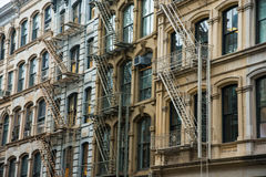 Office building in Soho district of New York City. Office building with fire escapes in Soho district of New York City Royalty Free Stock Photos