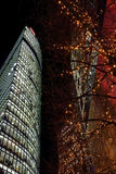 Office building in Sony Center. Berlin, Germany - 29.11.2016. Office building in Sony Center and tree decorated with Christmas lights at night. Berlin, Germany Royalty Free Stock Images