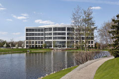 Office building in suburbs. With lake and path Stock Photography