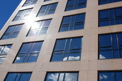 Office building with the sun. An office building with the sun reflecting Royalty Free Stock Images
