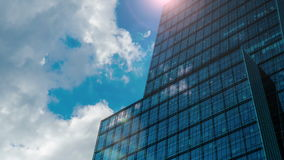 Office building with sun flare and cloud reflection 4K stock video footage