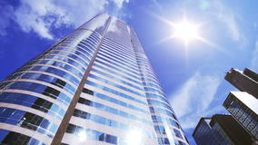Office building with sun flare 4K Royalty Free Stock Image