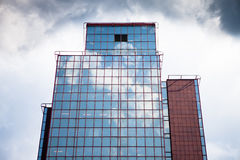 Office building in sweden. Office building in gothenburg sweden. Clouds are reflecting in the windows royalty free stock images