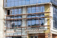 Office building under construction. building site with scaffoldi Stock Images