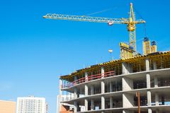 Office building under construction. And crane Royalty Free Stock Photography