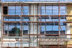 Office building under construction. scaffolding at building site Royalty Free Stock Photography
