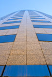 Office building upward perspective. Abstract view of modern glass and marble office building Stock Photo