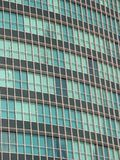 Office building windows. Sectional view of rows of windows in a high-rise office building Royalty Free Stock Images