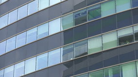 Office building windows, exterior view, panning stock video footage