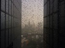 Office building windows with raindrops Royalty Free Stock Photo