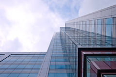 Office building from worm eyes view. High and glassy office building, from the worm eyes view, showing an interesting reflection Stock Image