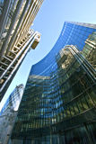 Office buildings. Cityscape with modern office buildings and London Gherkin, with blue tinted windows and facades reflections in financial district of London stock photo