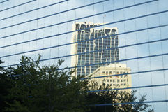 Office Buildings. Clouds and buildings reflecting in the glass structure of a bank building Stock Photo