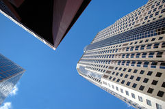 Office Buildings. Office and corporate buildings in perspective with bright blue sky Royalty Free Stock Photography
