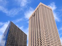Office buildings. Two office buildings in Minneapolis, Minnesota. Skyscrapers. Blue sky with white clouds Royalty Free Stock Photo