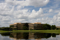 Office Buildings Across Lake. Office buildings as viewed across a small lake Stock Photos