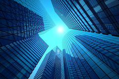 Office buildings. On a background of the blue sky and solar flare Royalty Free Stock Images