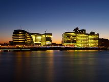 Office buildings on the bank of Thames River Royalty Free Stock Image