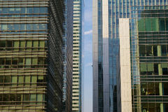 Office buildings in Canary Wharf. A single stripe of blue skye between office buildings in Canary wharf, London Stock Photography