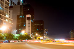 Office buildings in gurgaon with traffic light trails Royalty Free Stock Image