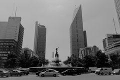 Office buildings at Mexico city. MEXICO CITY,MEXICO-SEPTEMBER 14,2016: Black and white photo showing the fountain know as `Diana la cazadora` monument, located Stock Image