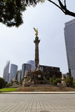 Office buildings at Mexico city. MEXICO CITY,MEXICO-SEPTEMBER 14,2016: Vertical shot of the Angel of Independance monument taken on a sunny day at Mexico city Stock Images