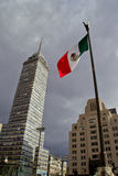 Office buildings at Mexico city. MEXICO CITY,MEXICO-SEPTEMBER 20 ,2016: View from below of the `Torre Latinoamericana` building and the mexican flag located at Stock Image